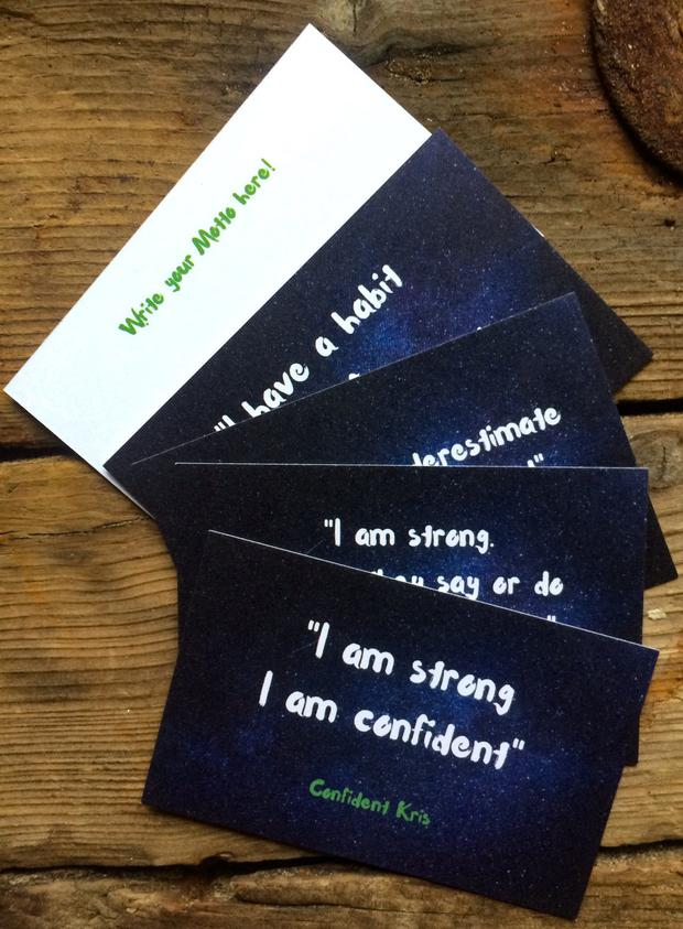 Confident Kris cards that come with the book