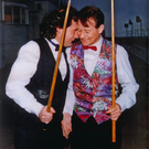 Jimmy White (left) and Alex Higgins share a joke during their snooker prime