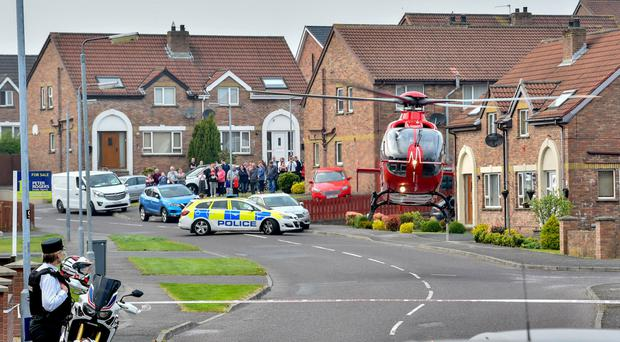 The Air Ambulance leaves Lawnbrook Drive in Newtownards following the collision