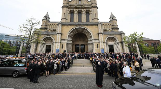 Mourners outside St Anne's Cathedral in Belfast city centre for the funeral of Lyra McKee yesterday