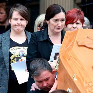 Lyra McKee's partner Sara Canning (far left) at the funeral