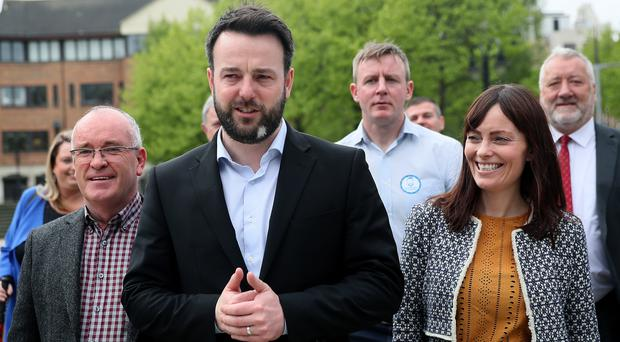 SDLP leader Colum Eastwood (centre) with deputy leader Nichola Mallon and other party members (Brian Lawless/PA)