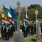 Flags are flown during the Saoradh Easter commemoration at Milltown Cemetery in Belfast (Niall Carson/PA)