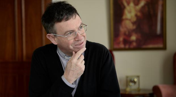 Reflective : Fr Martin Magill at the Parochial House in Belfast