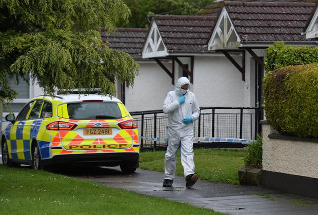 Police forensic officers at scene of murder of Niall Magee