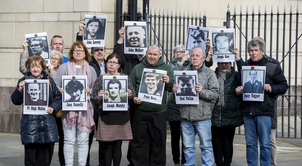 Families of the people who were killed during a disputed series of shootings in the Ballymurphy area of Belfast in August 1971 hold images of their loved ones with supporters outside Belfast Laganside Courts, Northern Ireland, during a new inquest into their loved ones deaths (Liam McBurney/PA)
