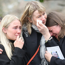 Relatives of Michael Lavery comfort each other