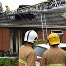 Firefighters attend a fire at a house in Meadowvale Park in Carryduff