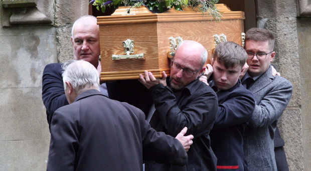 Simon Harper's coffin is carried out of the church