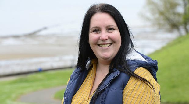 The Northern Bank has brought in new technology for helping the deaf after paying out £2,000 to Fiona McKendry after she alleged disability discrimination (Arthur Allison/Equality Commission/PA)