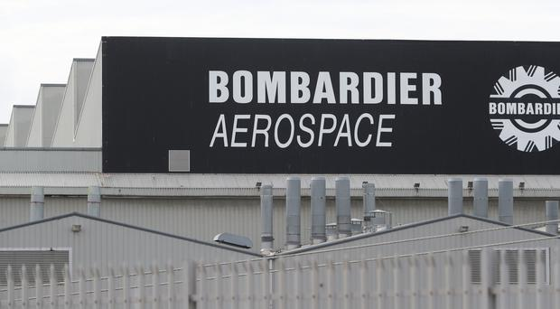 """Workers have vowed to """"raise hell"""" if the sale of aerospace firm Bombardier's Northern Ireland operation is followed by job losses (Niall Carson/PA)."""