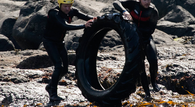 Volunteers help clean up rubbish from the nooks and crannies around the Giant's Causeway coastline