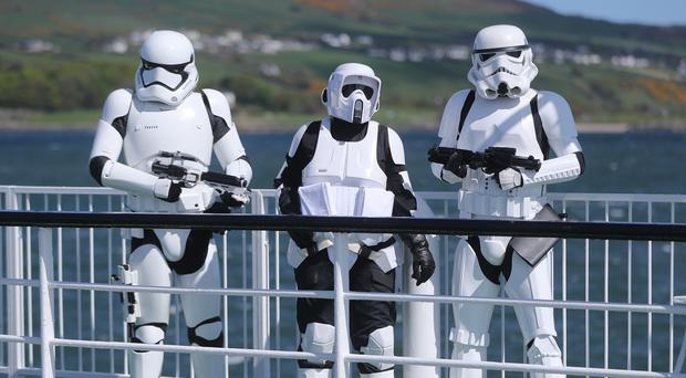 Members of the 501st Legion Ireland Garrison arrive at Greencastle in Co Donegal for the May the 4th Festival in Malin Head where scenes from Star Wars the Last Jedi where filmed (Niall Carson/PA)