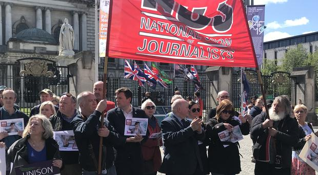 Members of the NUJ paused at Belfast City Hall during the May Day parade in Belfast to remember murdered journalist Lyra McKee. (Rebecca Black/PA)