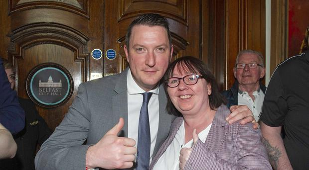 Sinn Fein's John Finucane celebrating with party colleague Mary Ellen Campbell during the local government election count at Belfast City Hall (Mark Marlow/PA)