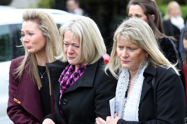 Family and friends at the funeral of Seamus Close in Lisburn yesterday