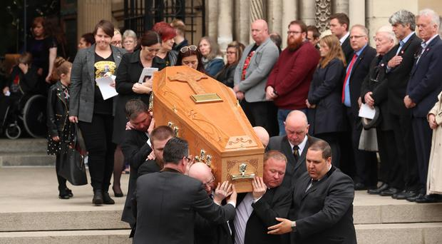 The coffin is carried from the funeral service of murdered journalist Lyra McKee at St Anne's Cathedral in Belfast (PA)