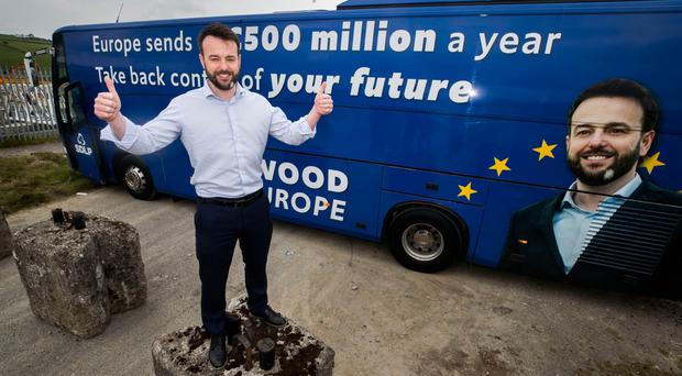 SDLP leader Colum Eastwood in front of his anti-Brexit bus