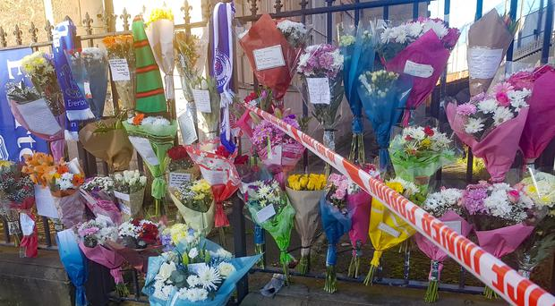 Floral tributes left near at the scene in east Belfast where community worker Ian Ogle was killed (Rebecca Black/PA)