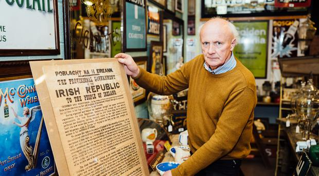 Auctioneer Victor Mee holds a rare first anniversary Irish Proclamation printed in 1917 (Gemma Gilfillan/PA)