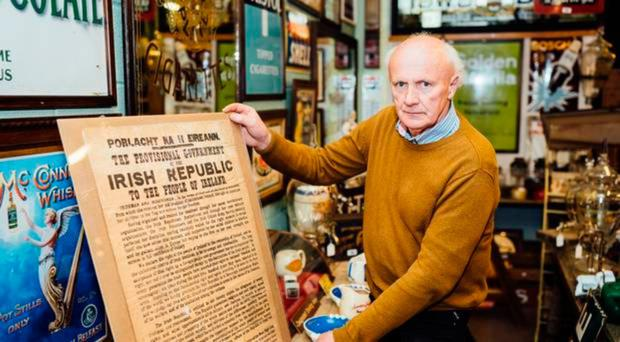 Auctioneer Victor Mee holds a rare first anniversary Irish Proclamation printed in 1917