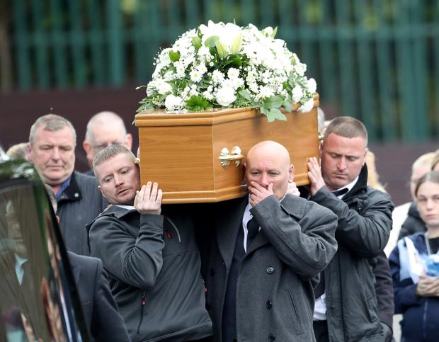 Edward McKay (front right) carries his daughter's coffin