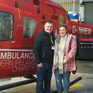 Eoghan and Kerrie Kerlin who visited the Air Ambulance NI base to thank the team who cared for the motocross racer after a serious accident in 2018