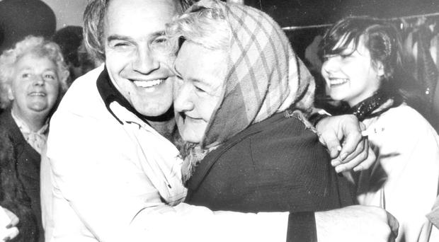 Freddie Starr hugs fan Kathleen Kinnard during a visit to Belfast in 1981