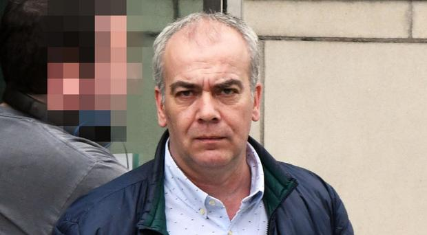 Colin Duffy leaves Belfast Crown Court yesterday