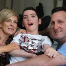 Liam McCallum with his parents Natasha and Alistair