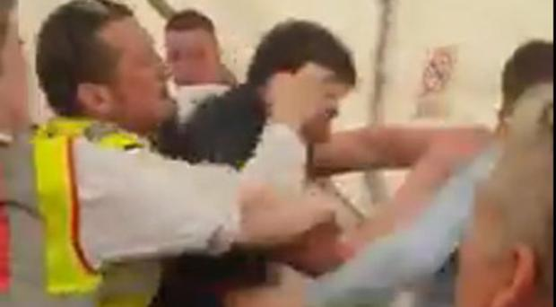 Video of the brawl shows event security staff struggling with drunken revellers in a bar tent