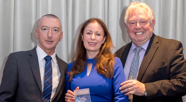 Award sponsor Sean Robinson of United Utilities and broadcaster Nick Ferrari present Belfast Telegraph editor Gail Walker with the accolade for Daily Newspaper of the Year at the Regional Press Awards in London