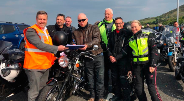 Bikers on their way to the North West 200 meet Finlay Carson (far left) to sign the petition