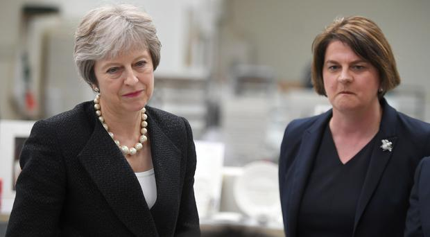 DUP leader Arlene Foster with Theresa May. (Clodagh Kilcoyne/PA)