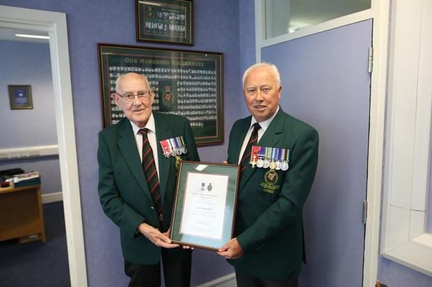 Ian being presented with the RUC George Cross Certificate of Appreciation by Stephen White, the chairman of the Royal Ulster Constabulary GC Foundation