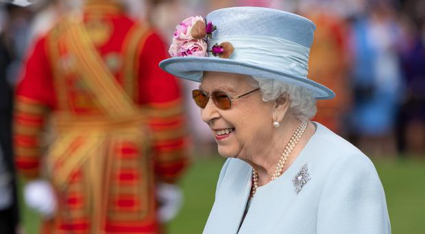 The Queen attending the royal garden party at Buckingham Palace (Dominic Lipinski/PA Wire)