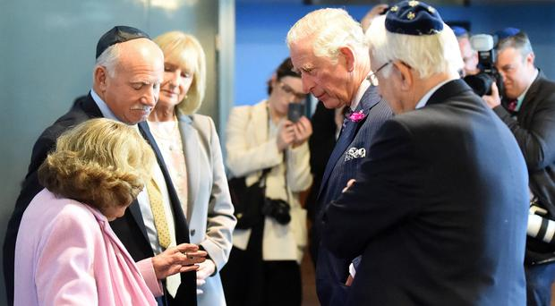 Charles meets Ruth Kohner, 82, who was part of the Kindertransport in 1939 which brought thousands of Jewish children to the UK (Joe Giddens/PA)