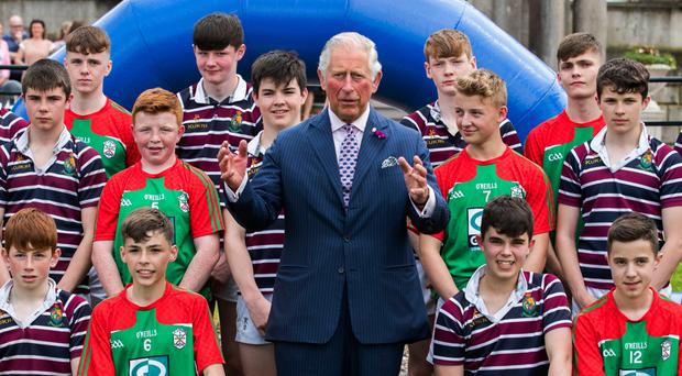 The Prince of Wales with pupils from Armagh's St Patrick's Grammar School and Royal School during an engagement at Palace Demense in the Cathedral City