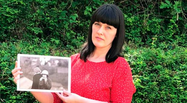 Ursula Duddy holds a picture of her brother Jim Gallagher