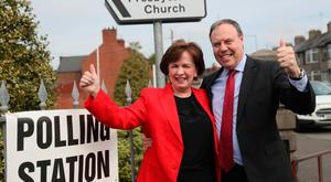 Diane Dodds and husband Nigel arrive to cast their votes in Banbridge