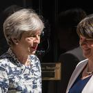 Arlene Foster, right, agreed her DUP MPs would prop-up Theresa May's Government following the 2017 general election (PA)
