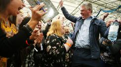 Alliance's Naomi Long celebrates with her husband Michael