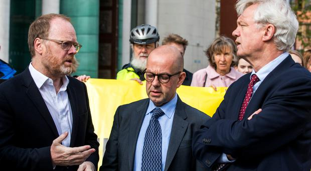 Investigative journalists Trevor Birney and Barry McCaffrey with MP David Davis at a previous court hearing. Credit: Liam McBurney/PA