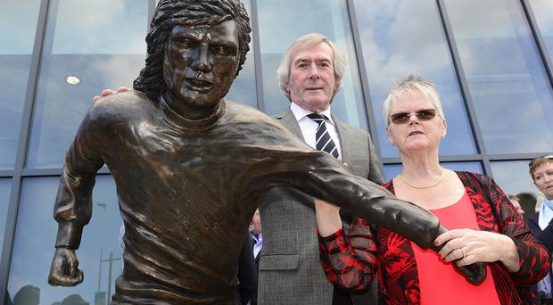 Pat Jennings helps Barbara McNarry unveil the statue of her brother George Best close to Windsor Park