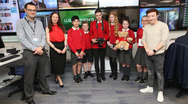 Belfast Telegraph's Deputy Digital Editor Jonathan Bell , Editor Gail Walker and photographer Kevin Scott with pupils from St MacNissi's Primary School during a visit to the Belfast Telegraph newsroom