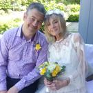 John Nightingale and Jill Cox on their wedding day at the Marie Curie Hospice in Belfast earlier this week