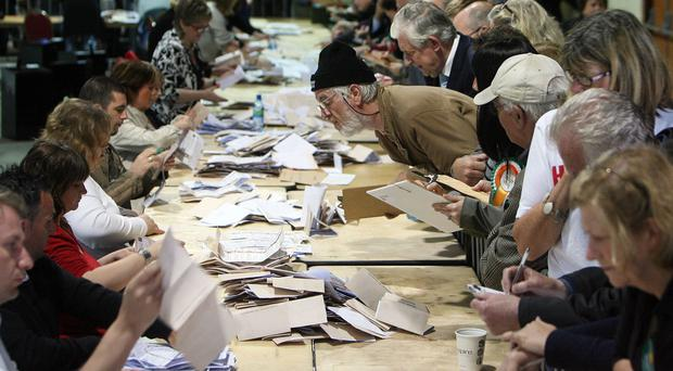 Counting votes as a recount has been granted (Niall Carson/PA)