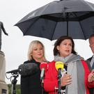 Sinn Fein's Michelle O'Neill, Mary Lou McDonald and Conor Murphy speaking to the media (Niall Carson/PA)