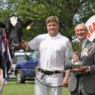 Champion Holstein cow Glasson Goldfish Form Erle with Simon Haffey and judge Cyril Millar