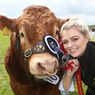 Julie Ann Cairns with the champion Limousin bull